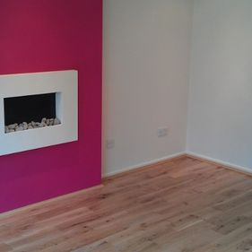 pink living room with fire